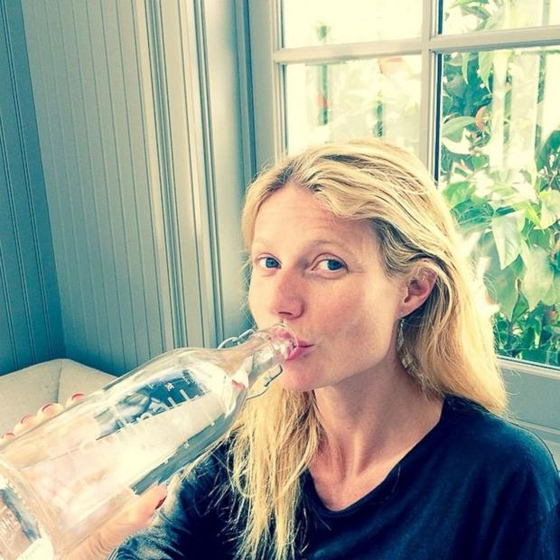 Gwyneth Paltrow cheated with a bottle of water, but still posted this selfie without a scrap of makeup.
