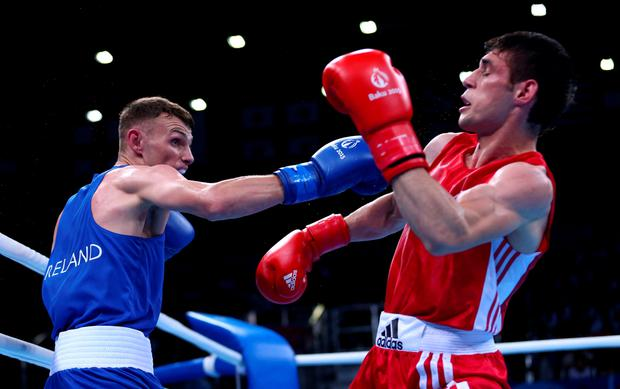 BAKU, AZERBAIJAN - JUNE 23: Sean McComb of Ireland (blue) and Yasin Yilmaz of Turkey (red) compete in the Men's Boxing Lightweight (60kg) Quarter Final during day eleven of the Baku 2015 European Games at the Crystal Hall on June 23, 2015 in Baku, Azerbaijan. (Photo by Harry Engels/Getty Images for BEGOC)