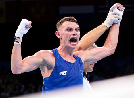 Ireland's Sean McComb celebrates after defeating Turkey's Yasin Yilmaz (not pictured) in the men's light (60kg) boxing quarterfinal bout at the 2015 European Games in Baku on June 23, 2015. AFP PHOTO / JACK GUEZJACK GUEZ/AFP/Getty Images