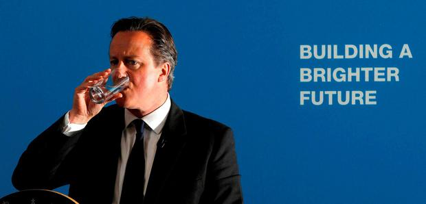 Britain's Prime Minister David Cameron pauses to take a drink of water as he talks to students during a visit to Ormiston Bolingbroke Academy in Runcorn, north east England, June 22, 2015. REUTERS/Peter Byrne/Pool