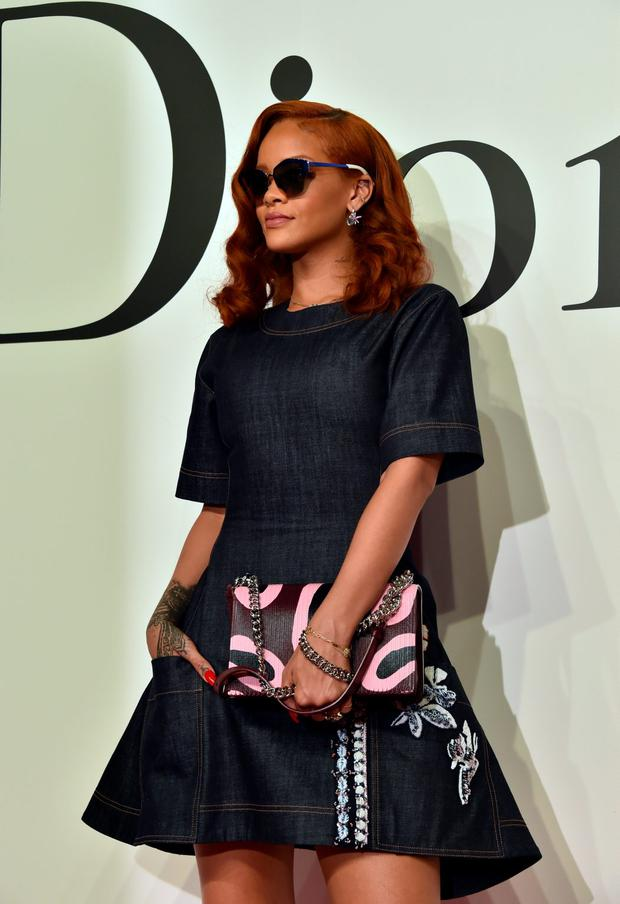 Pop star Rihanna poses at a photo call prior to the Christian Dior fall and winter collection at the National Art Center in Tokyo