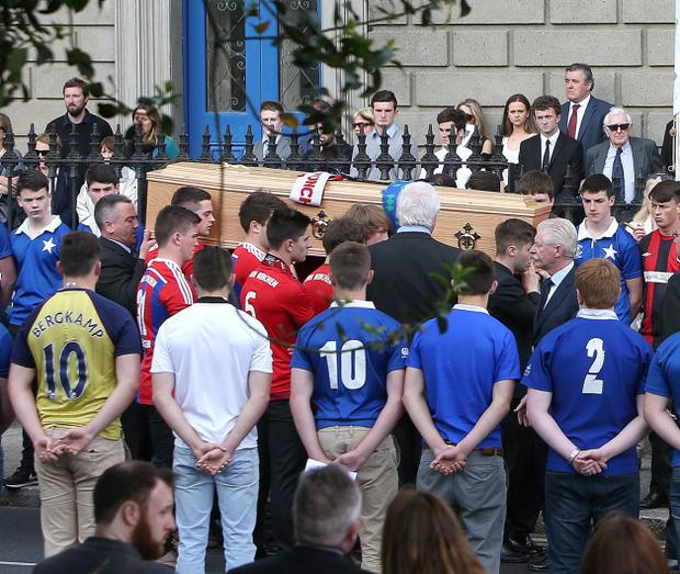 Friends wearing St Marys and Bayern Munich jerseys form a guard of honour as the coffin is carried into the Church of the Three Patrons, Rathgar for the funeral mass of Niccolai Schuster. Picture credit; Damien Eagers 23/6/2015