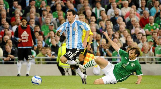 Lionel Messi, Argentina, in action against Kevin Kilbane, Republic of Ireland in 2010