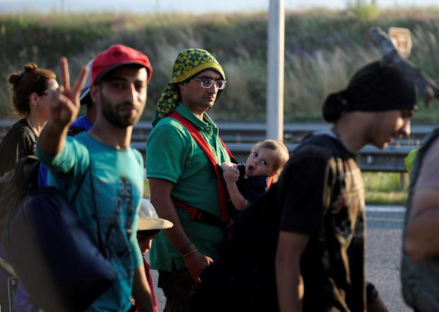 Syrian migrants on their way to Hungary, which has refused to take back migrants who cross through its borders to Austria Credit: Ognen Teofilovski