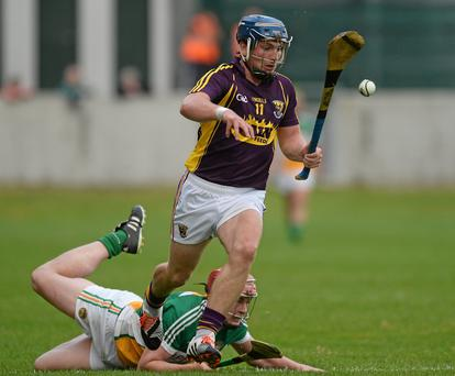 Man of the match Kevin Foley leaves Offaly's Conor Doughan in his tracks