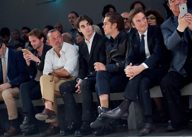 RJ Mitte, Ellar Coltrane and Pietro Beccari attend the Fendi show during the Milan Men's Fashion Week Spring/Summer 2016 on June 22, 2015 in Milan, Italy. (Photo by Jacopo Raule/Getty Images for Fendi)