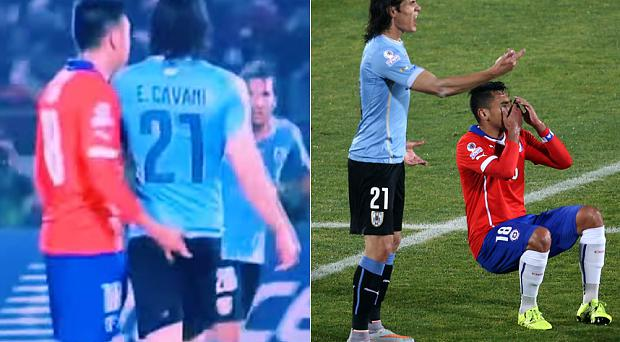 Edinson Cavani feels the presence of Gonzalo Jara, moments before slapping the defender and being sent off for Uruguay against Chile