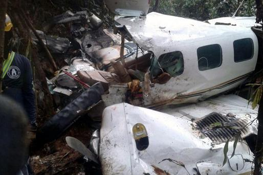 The light aircraft after it crashed in the jungle Credit: Getty Images