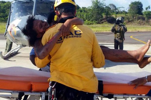 Rescue worker helps Maria Nelly Murillo after her rescue Credit: Getty Images