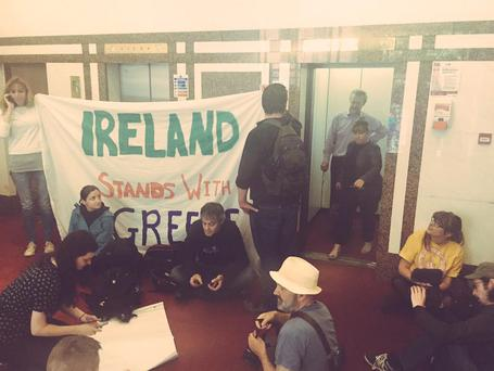 Members of the Greek Solidarity Committee in an EU office on Molesworth Street Credit: ronanburtenshaw