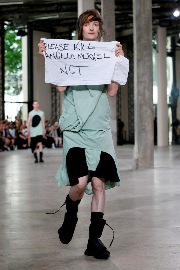 A model presents a creation by US designer Rick Owens during the men's Spring Summer collection fashion show in Paris