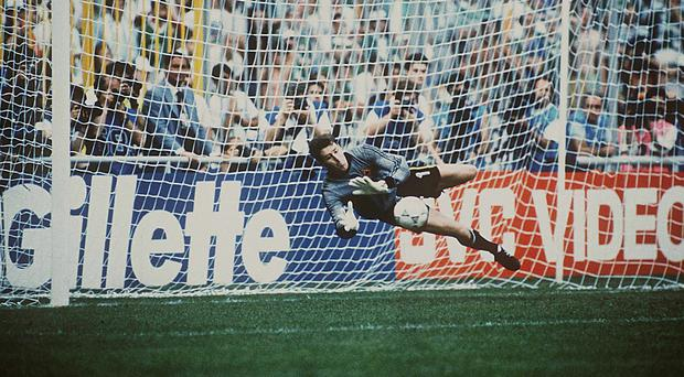 25 June 1990; Republic of Ireland goalkeeper Packie Bonner saves Romania's Daniel Timofte's shot during the penalty shoot-out. 1990 FIFA World Cup, Second Round, Republic of Ireland v Romania, Stadio Luigi Ferraris, Genoa, Italy. Picture credit: SPORTSFILE