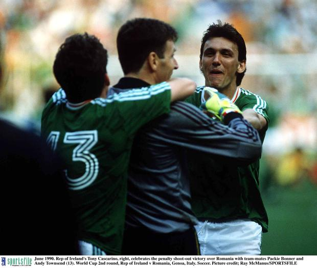 25 June 1990; Republic of Ireland's Tony Cascarino, right, celebrates the penalty shoot-out victory over Romania with team-mates Packie Bonner and Andy Townsend, 13. 1990 FIFA World Cup, Second Round, Republic of Ireland v Romania, Stadio Luigi Ferraris, Genoa, Italy. Picture credit: Ray McManus / SPORTSFILE