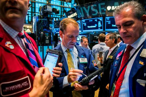 Traders work on the floor of the New York Stock Exchange in New York. Photo: Reuters