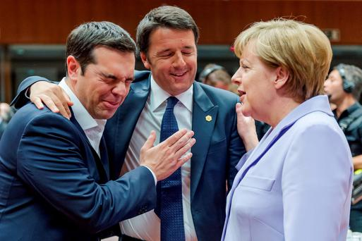 Italian Prime Minister Matteo Renzi, center, speaks with Greek Prime Minister Alexis Tsipras, left, and German Chancellor Angela Merkel during a round table meeting at an EU summit in Brussels on Thursday, June 25, 2015. (AP Photo/Geert Vanden Wijngaert)