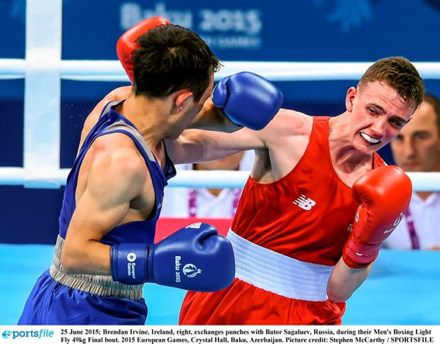 25 June 2015; Brendan Irvine, Ireland, right, exchanges punches with Bator Sagaluev, Russia, during their Men's Boxing Light Fly 49kg Final bout. 2015 European Games, Crystal Hall, Baku, Azerbaijan. Picture credit: Stephen McCarthy / SPORTSFILE