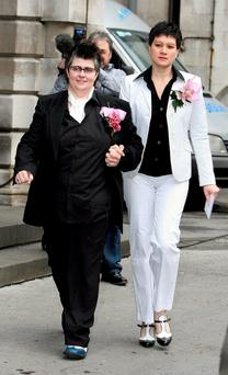 Shannon Sickles (right) and Grainne Close leaving Belfast City Hall following their civil partnership ceremony as two couples will go to court in Northern Ireland to mount a legal challenge against the region's ban on gay marriage Photo credit should read: Paul Faith/PA Wire