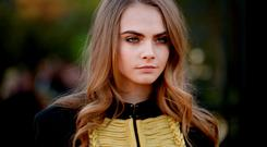 Model Cara Delevingne attends the Burberry