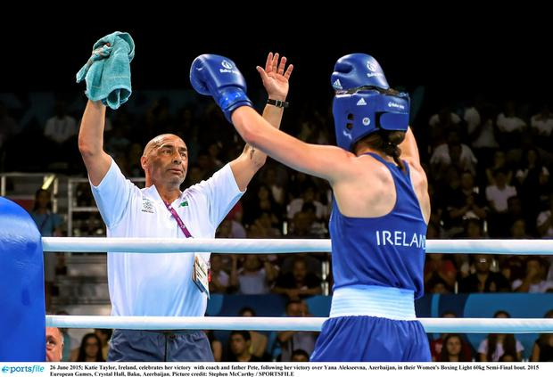 26 June 2015; Katie Taylor, Ireland, celebrates her victory with coach and father Pete, following her victory over Yana Alekseevna, Azerbaijan, in their Women's Boxing Light 60kg Semi-Final bout. 2015 European Games, Crystal Hall, Baku, Azerbaijan. Picture credit: Stephen McCarthy / SPORTSFILE
