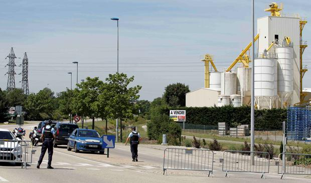 French Gendarmes block the access road to the industrial area of Saint-Quentin-Fallavier, outside Lyon