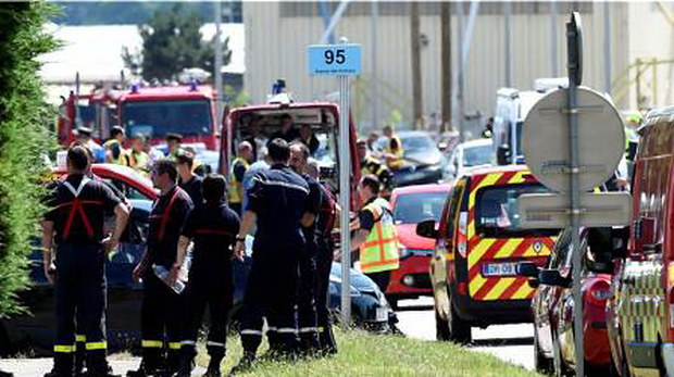 French police and firefighters at the entrance of the Air Products company near Lyon in France where a man was killed.