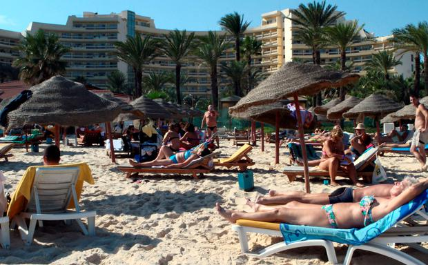 A file picture taken on October 31, 2013, shows tourists enjoying the beach near a four-star hotel in the resort town of Sousse, a popular tourist destination 140 kilometres (90 miles) south of the Tunisian capital. AFP PHOTO / BECHIR BETTAIEBBECHIR BETTAIEB/AFP/Getty Images