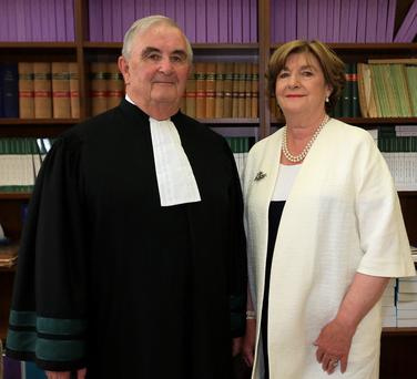 26/6/2015 Mr Justice John Murray and his wife, Gabrielle pictured at the Four Courts yesterday(Fri) following his final day on the bench of the Supreme Court.Pic: Courts Collins