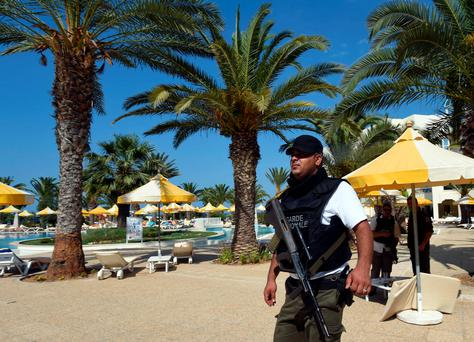 A Tunisian security member stands next to a swimming pool at the resort town of Sousse, a popular tourist destination 140 kilometres (90 miles) south of the Tunisian capital, on June 26, 2015, following a shooting attack. At least 27 people, including foreigners, were killed in a mass shooting at a Tunisian beach resort packed with holidaymakers, in the North African country's worst attack in recent history. AFP PHOTO / FETHI BELAIDFETHI BELAID/AFP/Getty Images