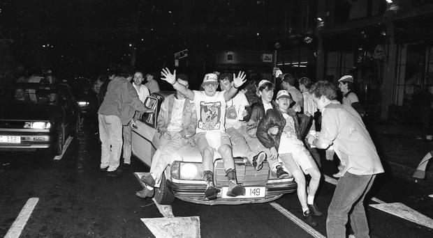 Irish fans celebrate in O'Connell Street during the magical few weeks of Italia 90, 25 years ago