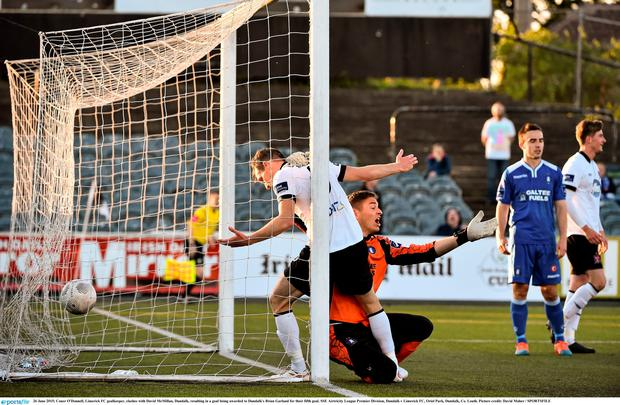Conor O'Donnell, Limerick FC goalkeeper, clashes with David McMillan, Dundalk, resulting in a goal being awarded to Dundalk's Brian Garland
