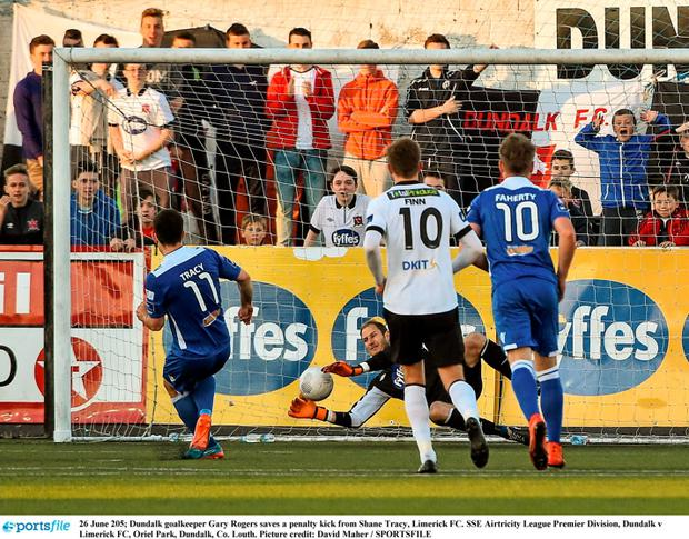 undalk goalkeeper Gary Rogers saves a penalty kick from Shane Tracy