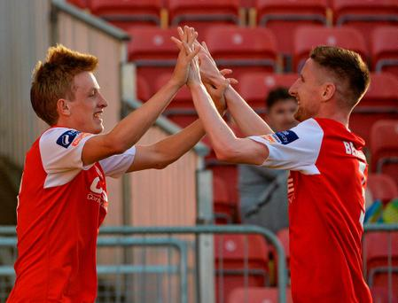 Chris Forrester, St Patrick's Athletic, celebrates with Ian Bermingham after scoring against Longford Town
