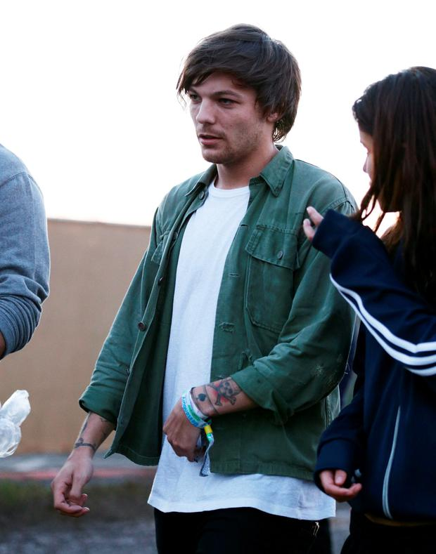 Louis Tomlinson from One Direction backstage at the Glastonbury Festival, at Worthy Farm in Somerset. PRESS ASSOCIATION Photo. Picture date: Friday June 26, 2015. Photo credit should read: Yui Mok/PA Wire