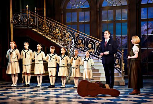 Family treat: Steven Houghton as Captain Von Trapp and Danielle Hope as Maria with the children in the Sound of Music, coming to Dublin in August. Photo: Pamela Raith.