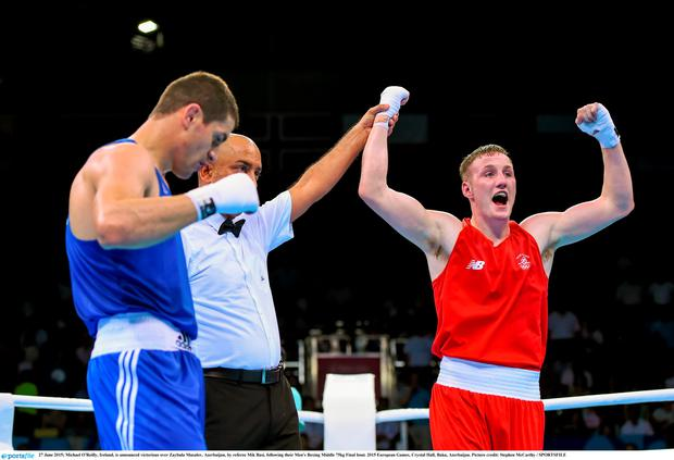 Michael O'Reilly, Ireland, is announced victorious over Zaybula Musalov, Azerbaijan, by referee Mik Basi, following their Men's Boxing Middle 75kg Final bout. 2015 European Games, Crystal Hall, Baku, Azerbaijan. Picture credit: Stephen McCarthy / SPORTSFILE