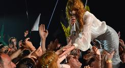 Florence Welch of Florence And The Machine performs live on the Pyramid stage during the first day of the Glastonbury Festival at Worthy Farm, Pilton on June 26, 2015 in Glastonbury, England.