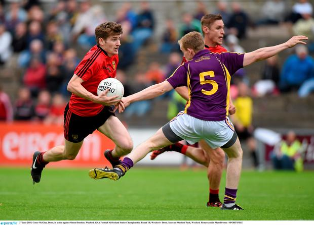 27 June 2015; Conor McGinn, Down, in action against Simon Donohoe, Wexford. GAA Football All-Ireland Senior Championship, Round 1B, Wexford v Down. Innovate Wexford Park, Wexford. Picture credit: Matt Browne / SPORTSFILE