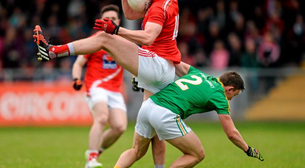 27 June 2015; Bevan Duffy, Louth, in action against Matthew Murphy, Leitrim. GAA Football All-Ireland Senior Championship, Round 1B, Louth v Leitrim. County Grounds, Drogheda, Co. Louth. Picture credit: Piaras Ó Mídheach / SPORTSFILE