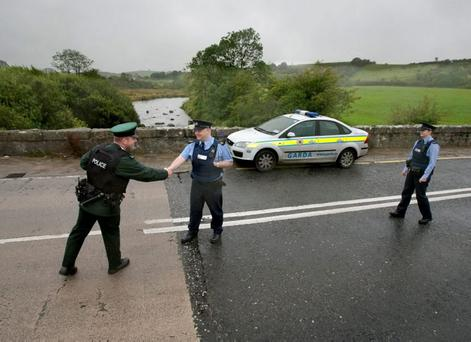 APATHY: PSNI and Garda officers shake hands at the border but the exchange programme is fizzling out after the murder of Det Gda Adrian Donohoe