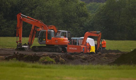 DIG FOR TRUTH: The search for Joe Lynskey in Coghalstown, Co Meath last week. Remains of two bodies, believed to be those of Seamus Wright and Kevin McKee, were found