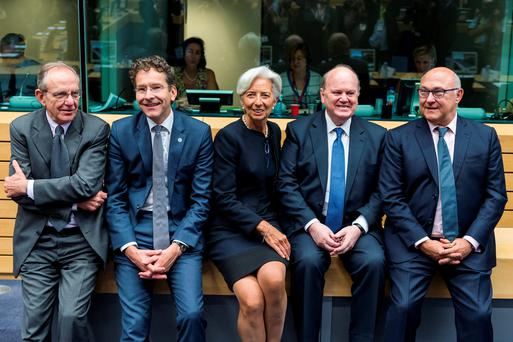 CRISIS MEETING: Michael Noonan pictured with IMF chief Christine Lagarde (centre); Dutch Finance Minister Jeroen Dijsselbloem, second left; Italy's Finance Minister Pier Carlo Padoan, far left, and France's Finance Minister Michel Sapin, far right, at a Greek debt meetiing in Brussles last week