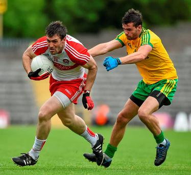 Derry's Mark Lynch in action against Donegal's Odhran Mac Niallais