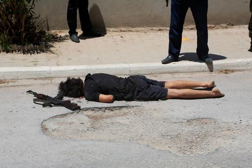 The gunman's body after Tunisian police shot him dead