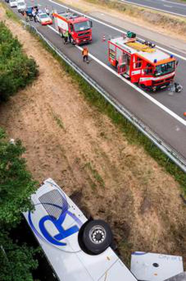 Fire and rescue vehicles line a highway as they attend to the Richmond Coach's bus which crashed on a motorway in Middlekerke, Belgium on Sunday. (AP Photo/Geert Vanden Wijngaert)