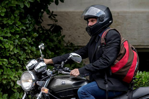 Greek Finance Minister Yanis Varoufakis leaves on his motorbike after a meeting at the office of Prime Minister Alexis Tsipras in Maximos Mansion in Athens, Greece June 28, 2015. Greece said it may impose capital controls and keep its banks shut on Monday after creditors refused to extend the country's bailout and savers queued to withdraw cash, taking Athens' standoff with the European Union and the International Monetary Fund to a dangerous new level. REUTERS/Marko Djurica