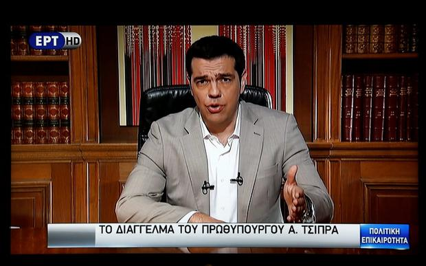 Greek Prime Minister Alexis Tsipras is seen on a television monitor while addressing the nation in Athens, Greece June 28, 2015. Greece's European partners shut the door on extending a credit lifeline to Athens, leaving the country facing a default that could push it out of the euro and cause ripple effects across the European economy and beyond. REUTERS/Pool