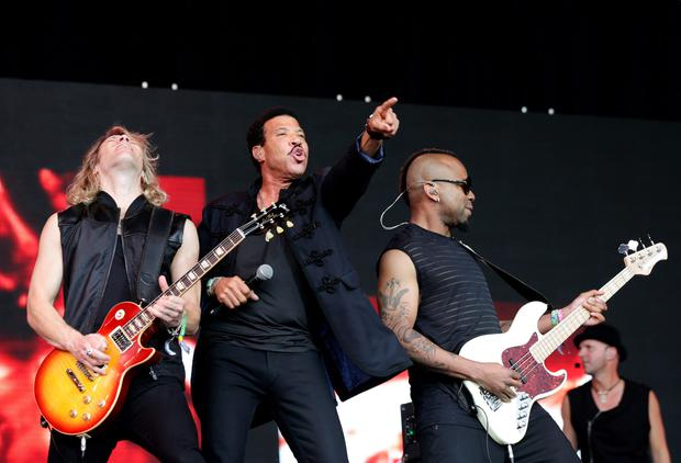 Lionel Richie (centre) performing on The Pyramid Stage during the Glastonbury Festival, at Worthy Farm in Somerset. PRESS ASSOCIATION Photo. Picture date: Sunday June 28, 2015. Photo credit should read: Yui Mok/PA Wire