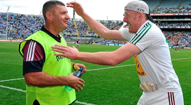 Westmeath selector Gary Connaughton goes to celebrate with manager Tom Cribben after the game