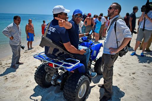 Armed police patrol Marhaba beach, in Sousse, Tunisia, where 38 people were killed in a terrorist attack on Friday. Photo: Getty