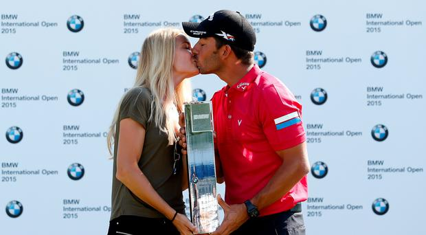 Pablo Larrazabal of Spain celebrates with his girlfriend Gala Ortin after winning the BMW International Open